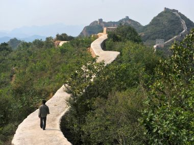 Chinese officials are being pilloried over the smoothing-over of a crumbling but much-loved 700-year-old section of the Great Wall of China - a UNESCO World Heritage Site - in the name of restoration. AP