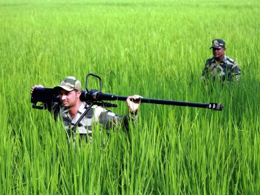 Indian Army soldiers patrol areas near the international border in Kashmir. PTI
