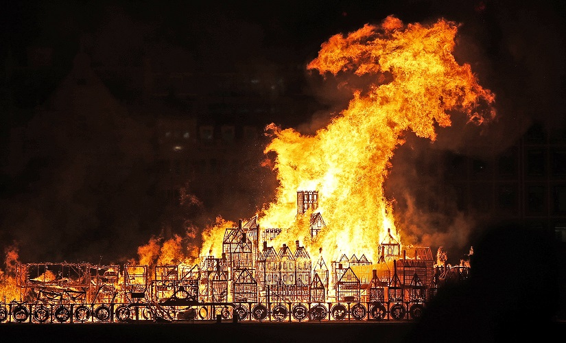 A 120-metre long sculpture of the 17th Century London skyline is set alight in a retelling of the story of the Great Fire of London in 1666. AP