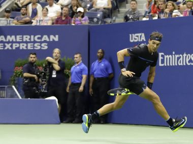 Rafael Nadal returns a shot between his legs at US Open. AP