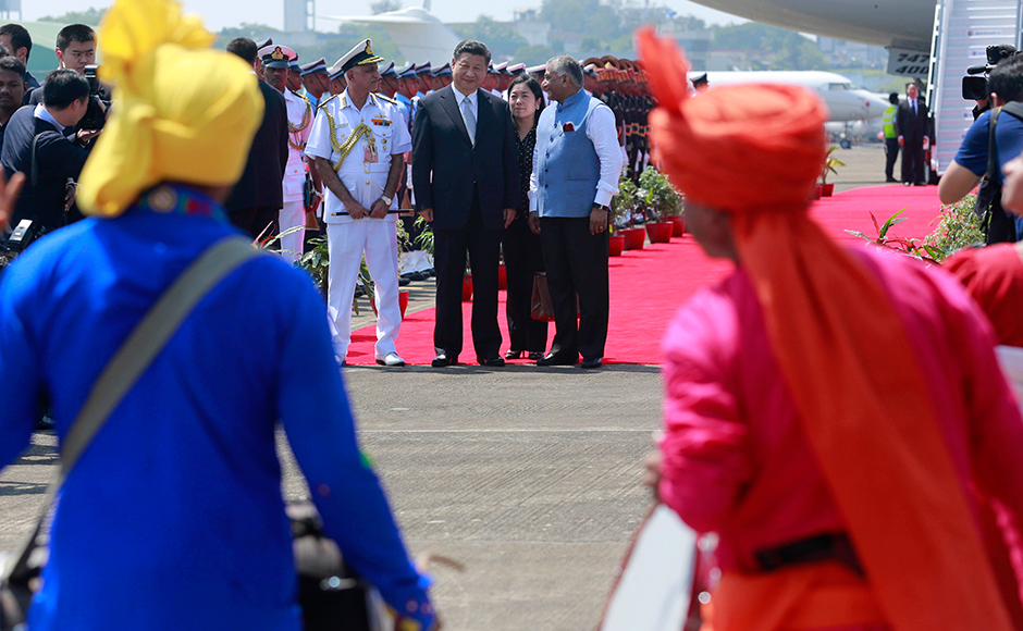 Chinese President Xi Jinping watches a cultural performance with Indian Junior Foreign Minister VK Singh, right, upon his arrival in Goa on Saturday. (Photo: AP)