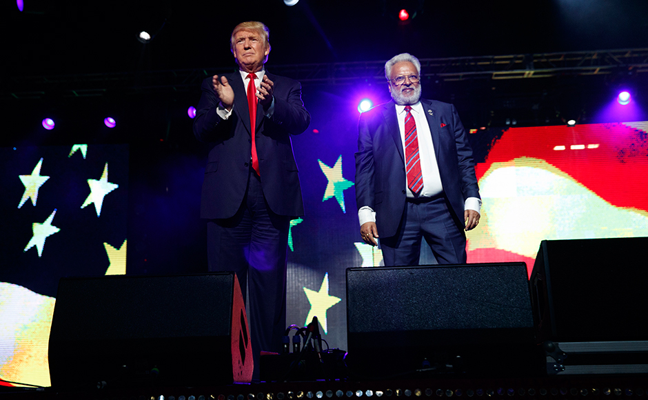 Republican presidential candidate Donald Trump, left, stands with Shall Kumar, chairman of the Republican Hindu Coalition, after delivering remarks, Saturday, Oct. 15, 2016, in Edison, N.J. (AP Photo/ Evan Vucci)