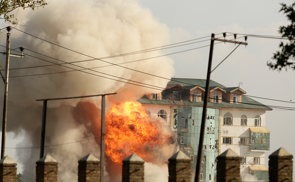 Flames rise after an explosive hits a government building where suspected militants have taken refuge during a gun battle in Pampore, on the outskirts of Srinagar, Indian controlled Kashmir, Monday, Oct. 10, 2016. On Monday, government forces were battling a group of suspected rebels near a highway running by saffron-rich Pampore town, on the outskirts of the region's main city of Srinagar. AP