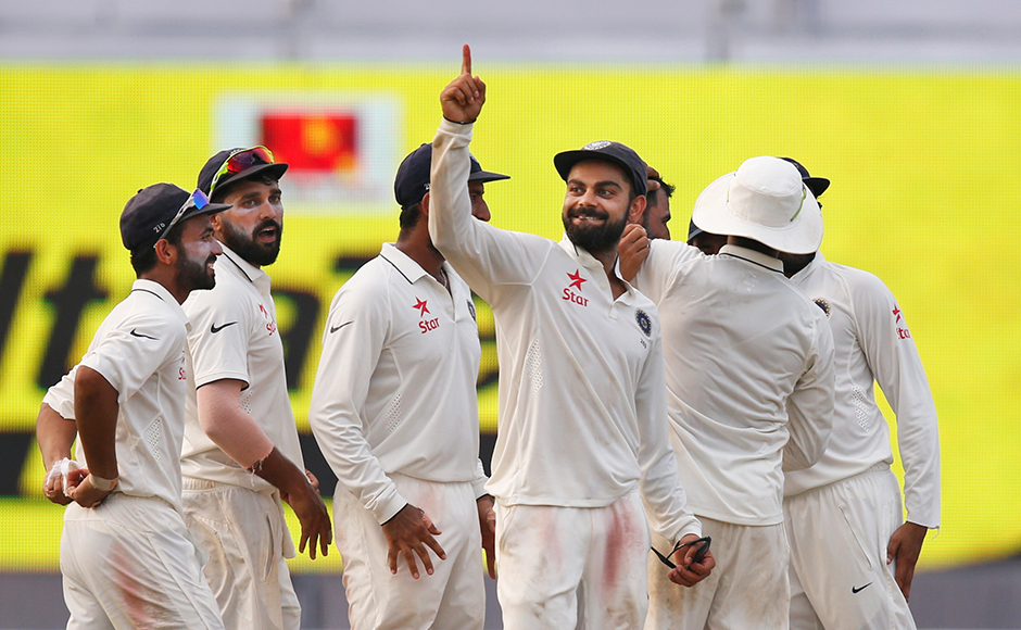 Indian cricket team captain Virat Kohli gestures during the match as India is likely to get the number one ranking amongst test teams after defeating New Zealand in two consecutive test matches, in Kolkata, India, Monday, Oct. 3, 2016. AP