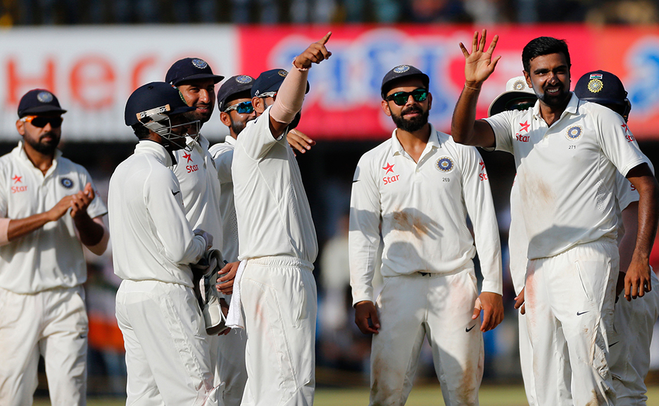 Indian bowler Ravichandran Ashwin, right, celebrates the wicket of New Zealand's Jeetan Patel during the fourth day of the third test cricket match between India and New Zealand in Indore, India, Tuesday, Oct. 11, 2016. (AP Photo/Rafiq Maqbool)