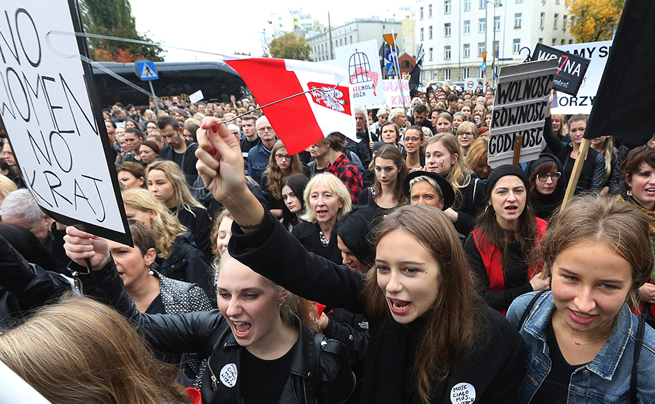 """Polish women donned black, waved black flags and took to Poland's streets on Monday, boycotting jobs and classes as part of a nationwide strike to protest a legislative proposal for a total ban on abortion. Some businesses and restaurants were also closed on what is being called """"Black Monday,"""" an expression of outrage against a proposal to further restrict an abortion law that is already one of the most limited in Europe. (Photos: AP)"""