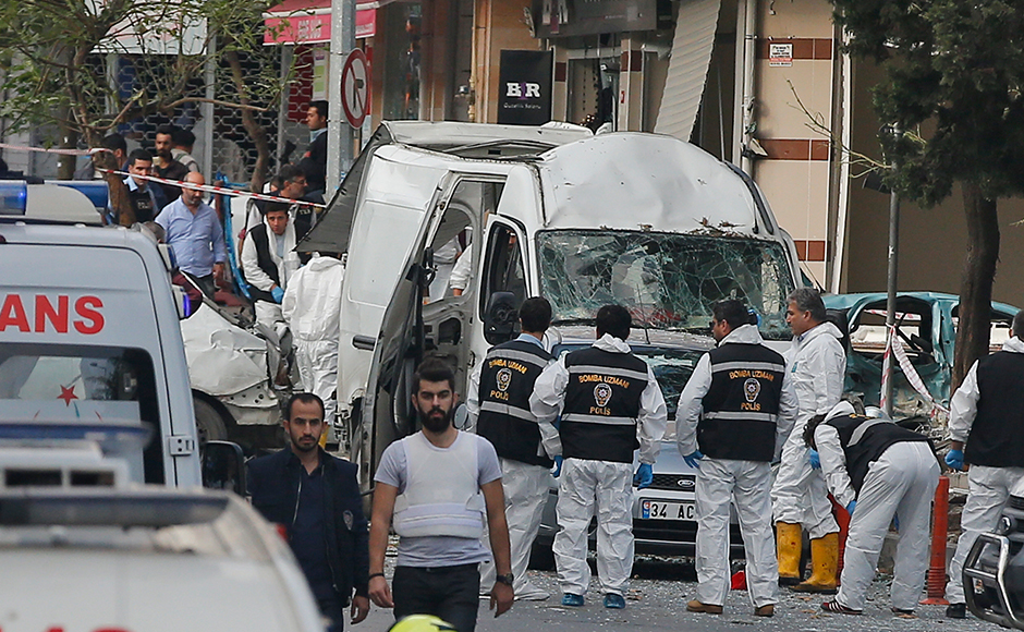 Police work at the scene of a blast in Istanbul, Thursday, Oct. 6, 2016. A bomb placed on a motorcycle has exploded near a police station Thursday, wounding several people, Vasip Sahin, the governor for Istanbul, said. AP