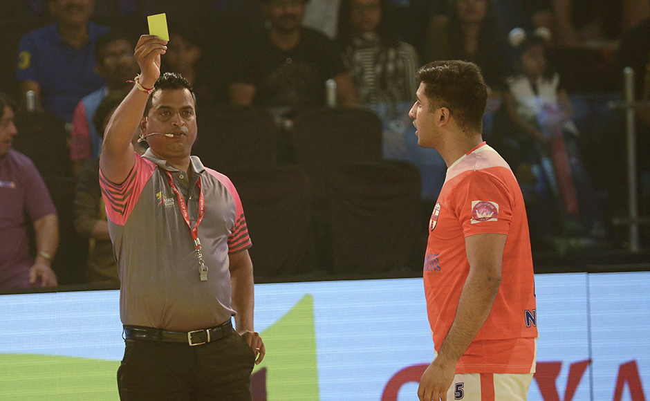 England kabaddi player, Nikesh Farmah (R) is shown the yellow card during a match between England and Bangladesh at the TransStadia in Ahmedabad on October 8, 2016. The 2016 Kabaddi World Cup tournament runs from October 7 - 22, 2016.