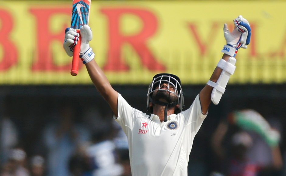 Indian batsman Ajinkya Rahane celebrates his century during the second day of the third test cricket match between India and New Zealand in Indore, India on Sunday