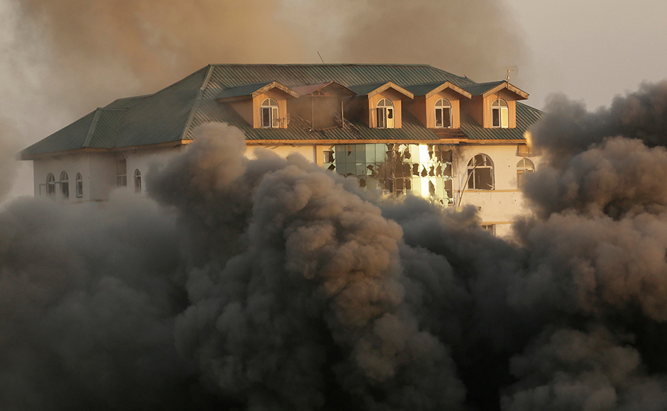 Smoke and dust engulf a government building where suspected militants have taken refuge during a gun battle in Pampore, on the outskirts of Srinagar, Indian controlled Kashmir, Monday, Oct. 10, 2016. On Monday, government forces were battling a group of suspected rebels near a highway running by saffron-rich Pampore town, on the outskirts of the region's main city of Srinagar. AP