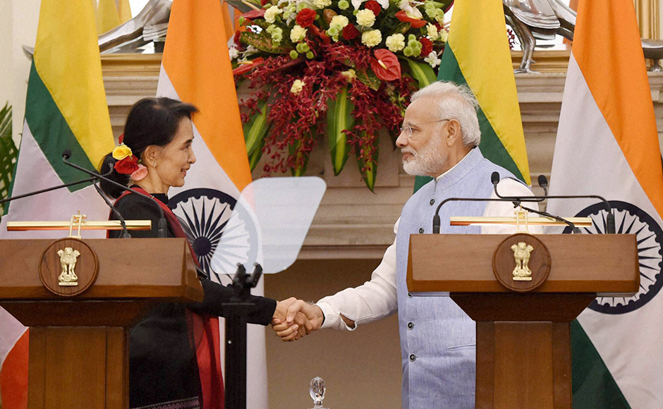 Prime Minister Narendra Modi shakes hands with Myanmar State Counsellor and Foreign Minister Aung San Suu Kyi after their joint press statement at Hyderabad House, in New Delhi on Wednesday. PTI Photo by Manvender Vashist (PTI10_19_2016_000156B)