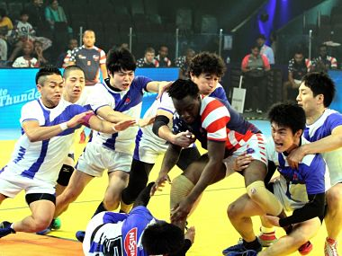 Japan and USA team in action at the Kabaddi World Cup.