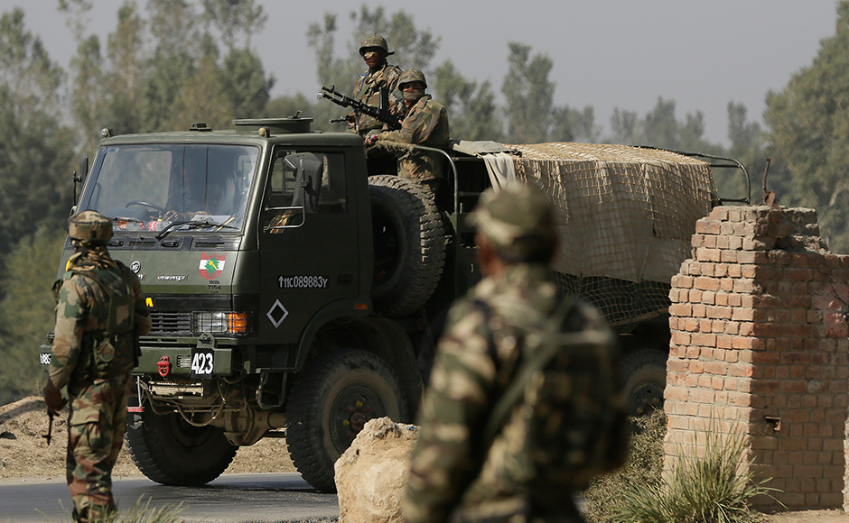 Indian army soldiers cordon off the area near the government building where suspected militants have taken refuge during a gun-battle, in Pampore, on the outskirts of Srinagar, Indian controlled Kashmir, Monday, Oct. 10, 2016. Government forces were battling a group of suspected rebels inside a government compound on Monday in the Indian-controlled portion of Kashmir. AP