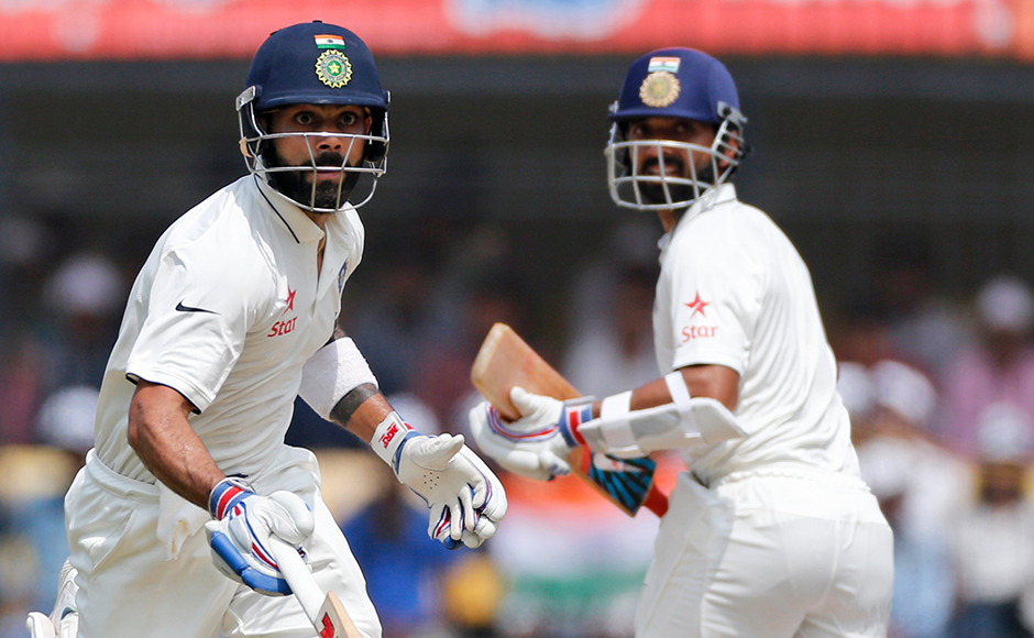 Indian cricket captain Virat Kohli, left, runs between the wicket with Ajinkya Rahane during the second day of the third test cricket match between India and New Zealand in Indore, India on Sunday