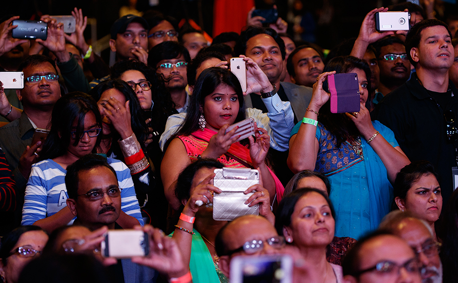 People look on as Republican presidential candidate Donald Trump speaks to the Republican Hindu Coalition, Saturday, Oct. 15, 2016, in Edison, N.J. (AP Photo/ Evan Vucci)