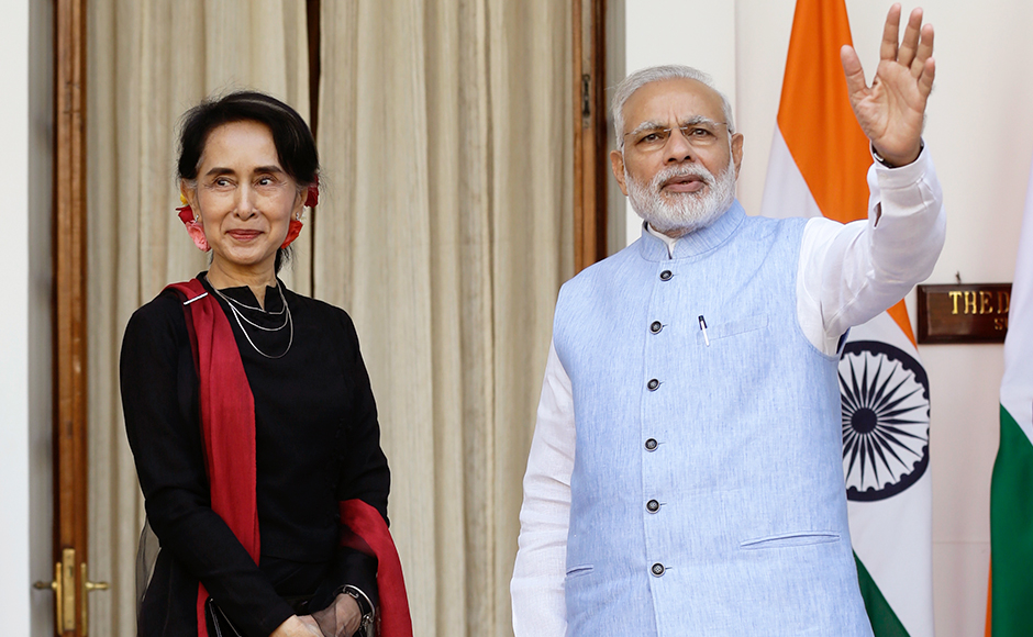 Indian Prime Minister Narendra Modi, right, receives Myanmar's Foreign Minister Aung San Suu Kyi before a bilateral meeting in New Delhi, India, Wednesday, Oct. 19, 2016, (AP Photo/Saurabh Das)