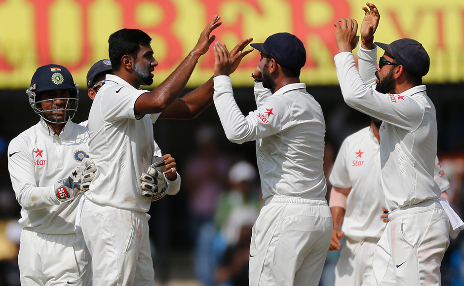 Indian players celebrate the wicket of New Zealand's cricket captain Kane Williamson during the fourth day of the third test cricket match between India and New Zealand in Indore, India, Tuesday, Oct. 11, 2016. (AP Photo/Rafiq Maqbool)