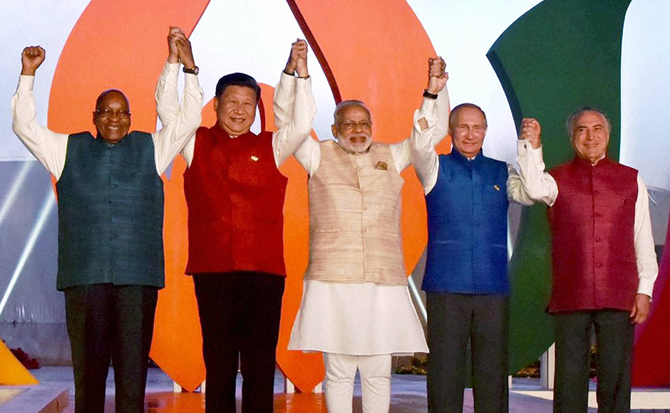 Prime Minister Narendra Modi with Brazil President, Michel Temer, South Africa President, Jacob Zuma, Russian President Vladimir Putin and Chinese President Xi Jinping pose for a group photo at the informal dinner in Benaulim, Goa on Saturday. (Photo: PTI)