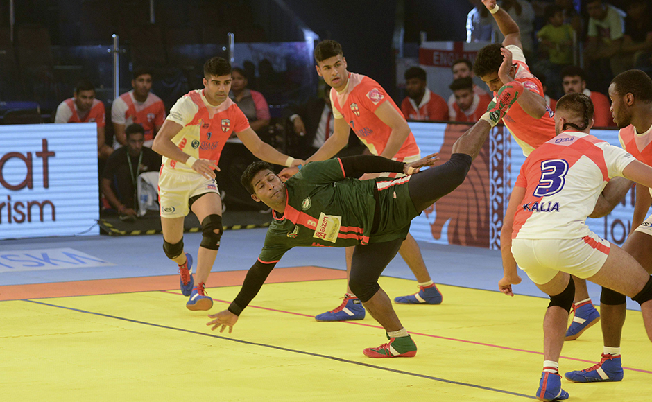 Bangladeshi kabaddi player, MD. Zakir Hossain (C) atempts against England opponents during a match between England and Bangladesh at the TransStadia in Ahmedabad on October 8, 2016. The 2016 Kabaddi World Cup tournament runs from October 7 - 22, 2016.