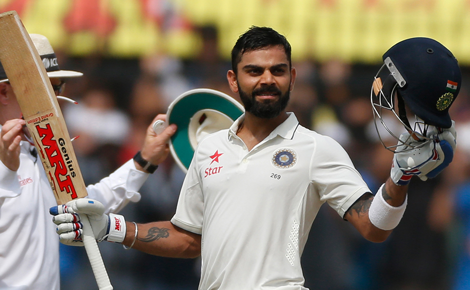 Indian cricket team captain Virat Kohli celebrates his double century during the second day of the third test cricket match between India and New Zealand in Indore, India on Sunday