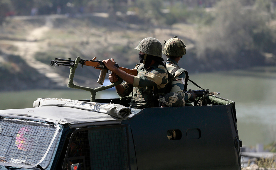 Indian soldiers on top of an armored vehicle secure the area near the government building where suspected militants have taken refuge during a gun-battle in Pampore, near Srinagar, Indian controlled Kashmir, Monday, Oct. 10, 2016. Government forces were battling a group of suspected rebels inside a government compound on Monday in the Indian-controlled portion of Kashmir. AP