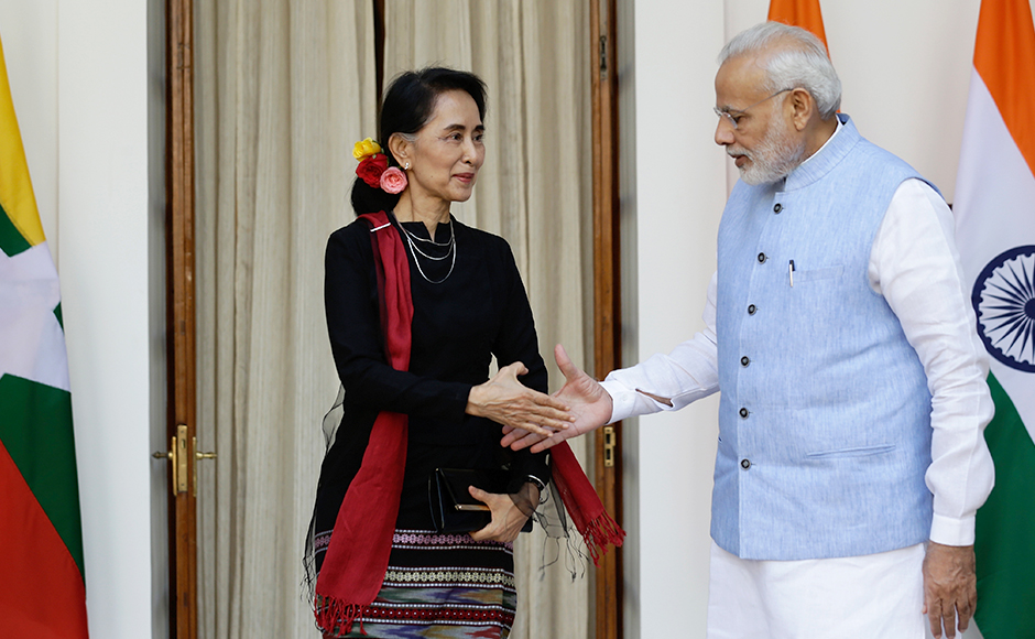 Indian Prime Minister Narendra Modi, right, shakes hands with Myanmar's Foreign Minister Aung San Suu Kyi, before a bilateral meeting in New Delhi, India, Wednesday, Oct. 19, 2016, (AP Photo/Saurabh Das)