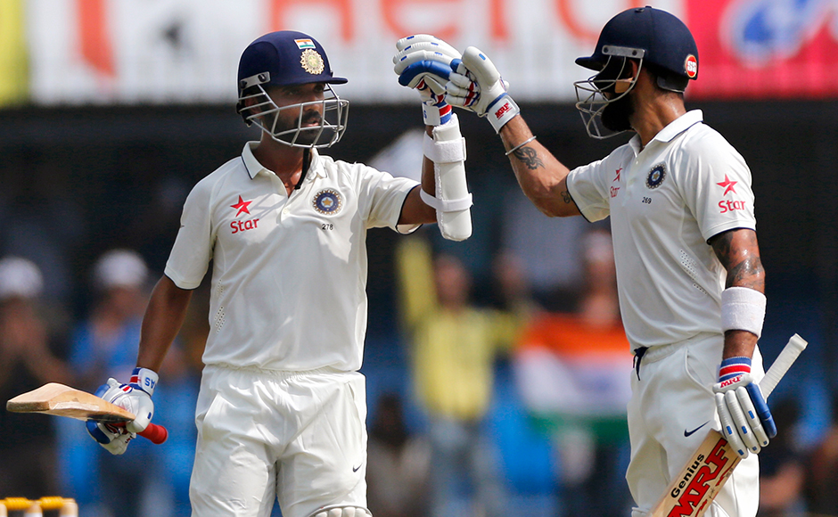 Indian batsman Ajinkya Rahane, left, celebrates his century with team captain Virat Kohli during the second day of the third test cricket match between India and New Zealand in Indore, India on Sunday