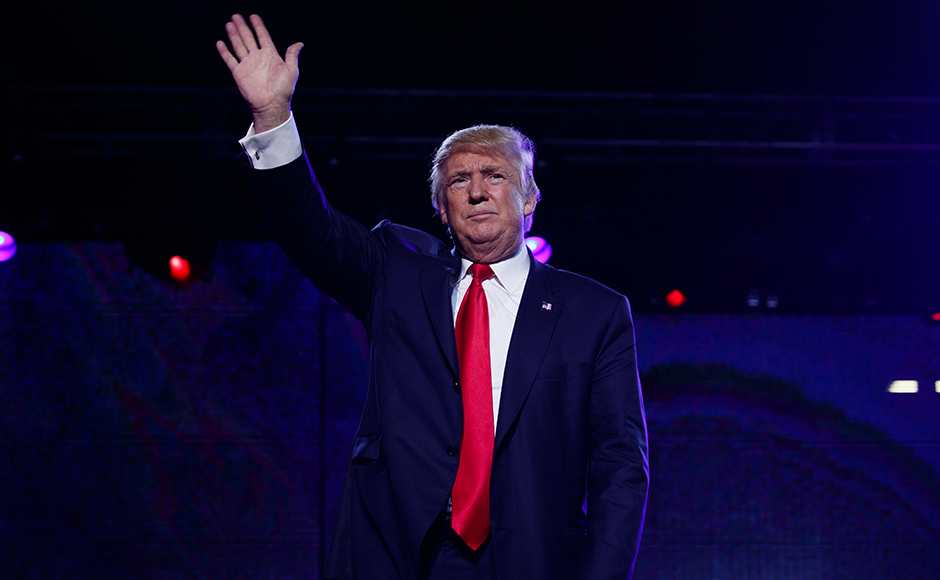 Republican presidential candidate Donald Trump waves after speaking to the Republican Hindu Coalition, Saturday, Oct. 15, 2016, in Edison, N.J. (AP Photo/ Evan Vucci)