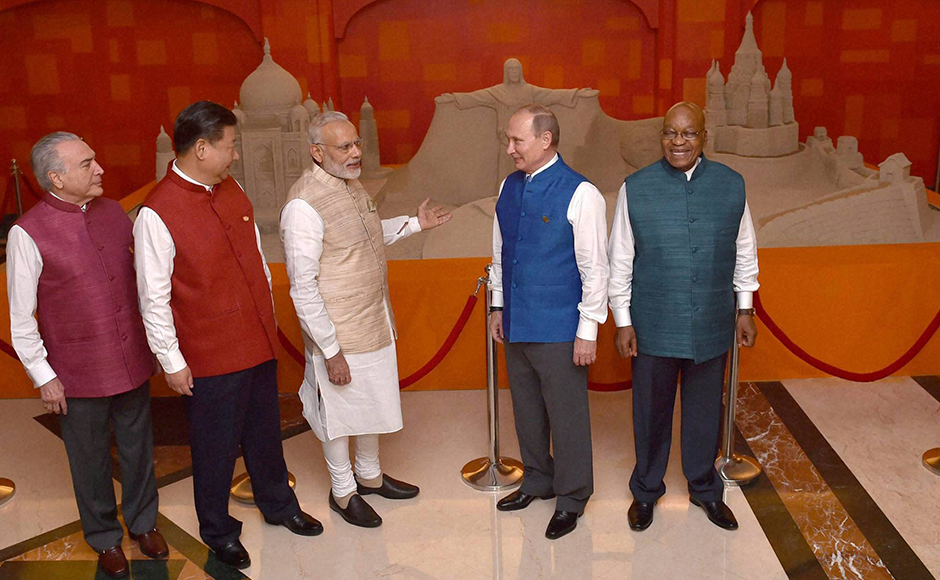 Prime Minister Narendra Modi with Brics leaders Michel Temer, President of Brazil, Jacob Zuma, President of South Africa, Russian President Vladimir Putin, Chinese President Xi Jinping wearing Khadi jackets in front of sand sculpture made by Sudarsan Pattnaik ahead of 17th India-Russia annual summit meet in Goa on Saturday. (Photo: PTI)