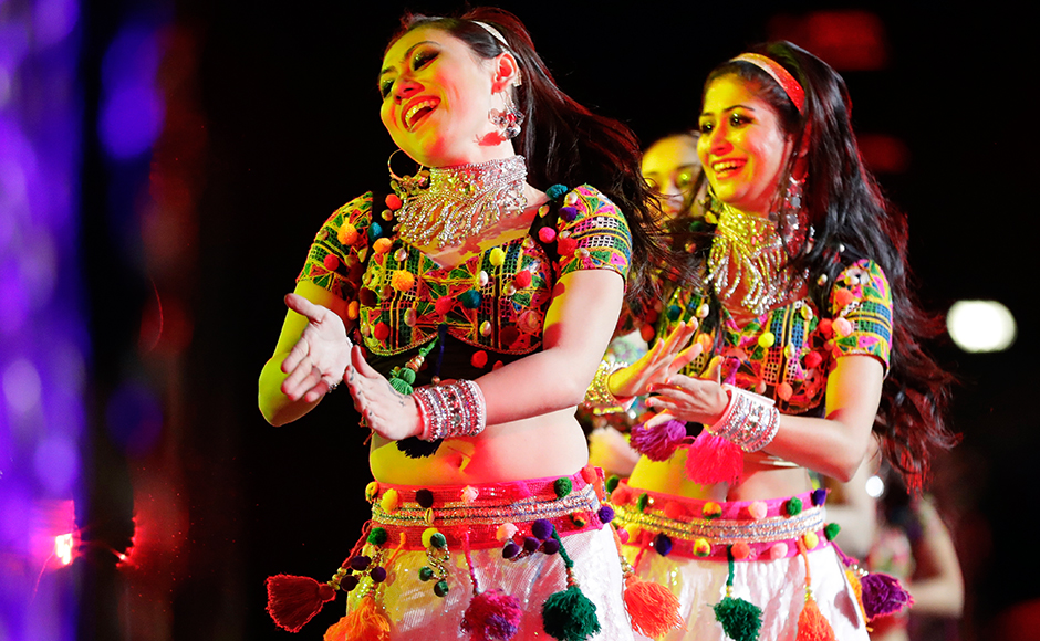 Dancers perform during a charity event hosted by the Republican Hindu Coalition, Saturday, Oct. 15, 2016, in Edison, N.J. Republican presidential candidate Donald Trump spoke during the event. (AP Photo/Julio Cortez)