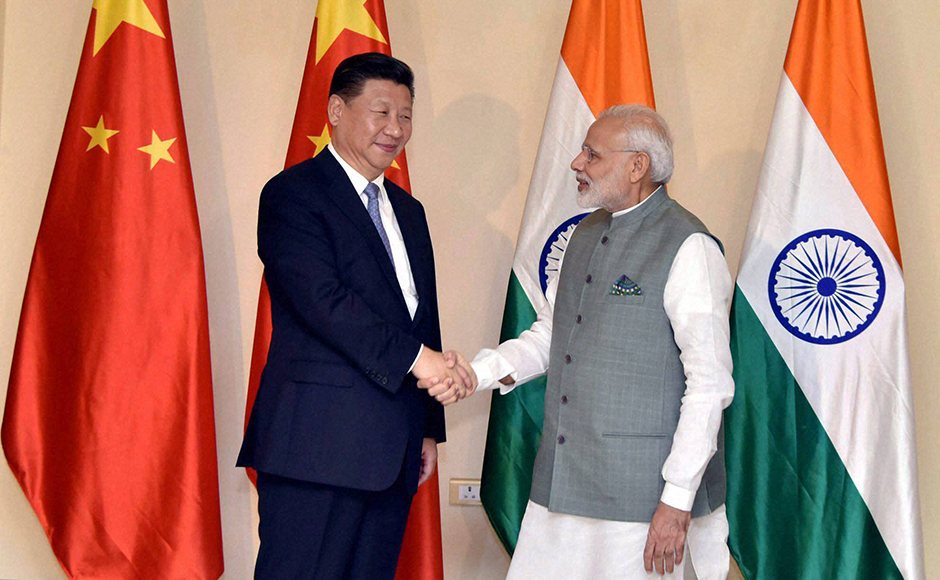 Prime Minister Narendra Modi greets Chinese President Xi Jinping ahead of Brics summit in Goa on Saturday. (Photo: PTI)