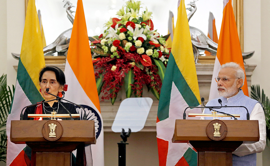 Myanmar's State Counsellor Aung San Suu Kyi (L) reads a joint statement as Indian Prime Minister Narendra Modi watches at Hyderabad House in New Delhi, India October 19, 2016. REUTERS/Adnan Abidi