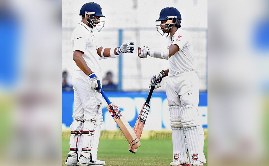 India cricketer Wriddhiman Saha celebrate his 50 run with Mohammed Shami during 4th day India vs New Zealand 2nd Test match at Eden Garden in Kolkata on Monday. PTI Photo by Ashok Bhaumik(PTI10_3_2016_000031B)