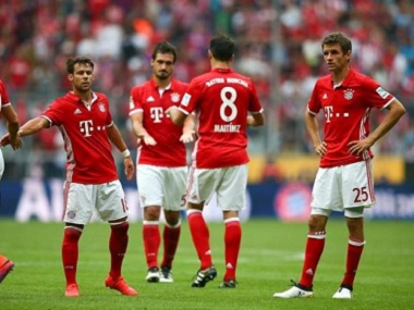 Bayern Munich players react after being held for a draw by Cologne. Reuters