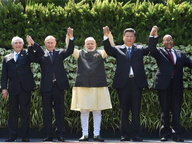 Brics leaders posing for a group photo before the summit in Benaulim, Goa. PTI