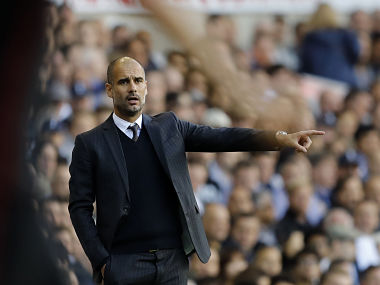 Manchester City''s manager Pep Guardiola gestures towards his players from the sidelines during the Premier League clash between Tottenham Hotspur. AP