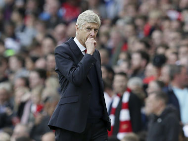 Arsenal manager Arsene Wenger looks across the pitch during the English Premier League clash against Swansea City. AP