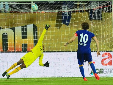 Diego Forlan of Mumbai City FC scores from the spot against NorthEast United FC. Sportzpics