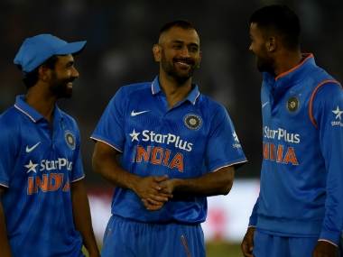 Dhoni (C) promoted himself up the order and had a magnificent partnership with Virat Kohli. AFP