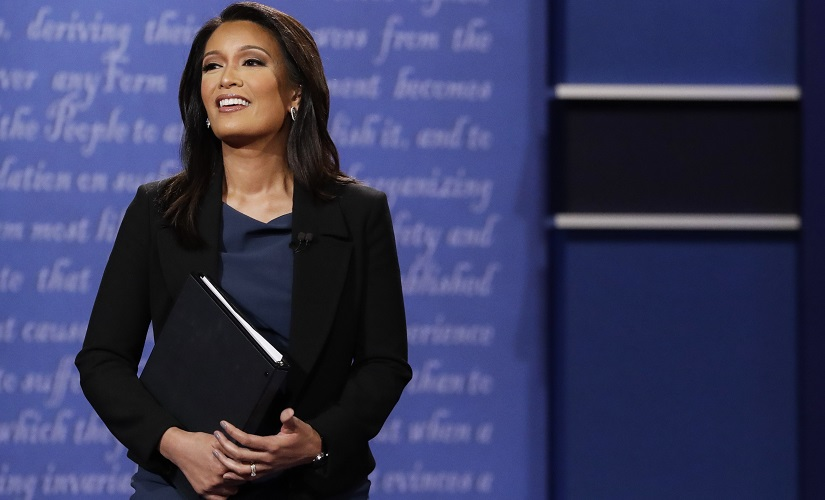 Moderator Elaine Quijano of CBS News addresses the audience before the debate. AP