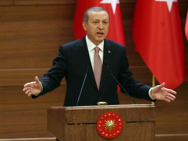 "Turkish President Recep Tayyip Erdogan delivers a speech during a mukhtars meeting at the presidential palace on November 26, 2015 in Ankara. President Recep Tayyip Erdogan on November 26 said Turkey does not buy any oil from Islamic State, insisting that his country's fight against the jihadist group is ""undisputed"". AFP PHOTO/ADEM ALTAN / AFP / ADEM ALTAN"