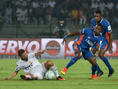FC Goa' players in action against Northeast United FC. AFP