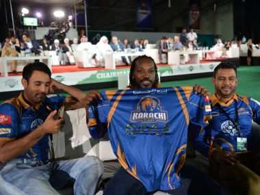 Chris Gayle poses with his Karachi jersey at the inauguration of the PSL. AFP
