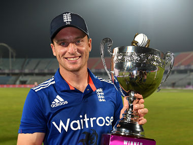 England captain Jos Buttler lifts the series trophy after winning the 3rd One Day International match against Bangladesh. Getty Images