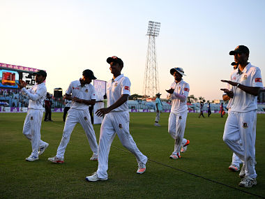 Mehedi Hasan of Bangladesh leads his team from the field at stumps during the first Test match against England. Getty Images