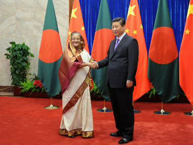 Bangladesh PM Sheikh Hasina (left) with Chinese President Xi Jinping. Reuters