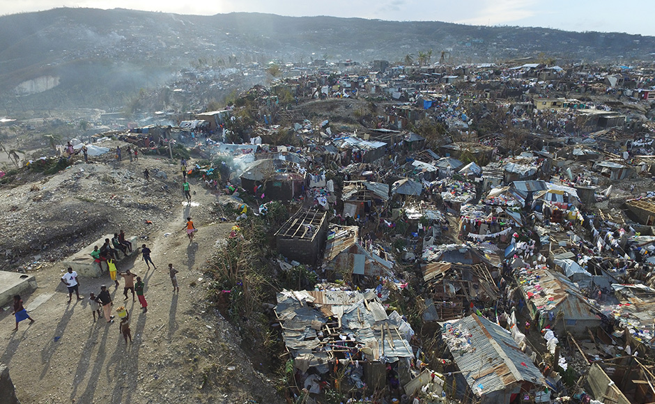 The number of deaths in Haiti, the poorest country in the Americas, surged to at least 877 on Friday as information trickled in from remote areas previously cut off by the storm. AP