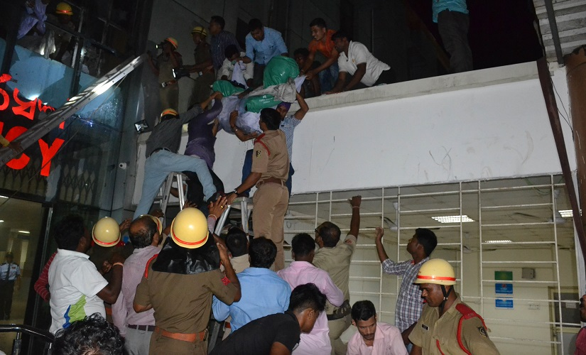 Patients being evacuated from the ICU of the SUM Hospital on Monday night. Firstpost/Biswa Ranjan