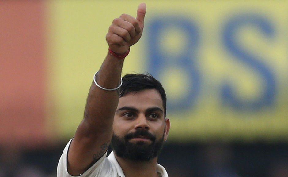 Indian cricket captain Virat Kohli celebrates his century on the first day of their third cricket test match against New Zealand in Indore, India, Saturday, Oct. 8, 2016. (AP Photo/Rafiq Maqbool)