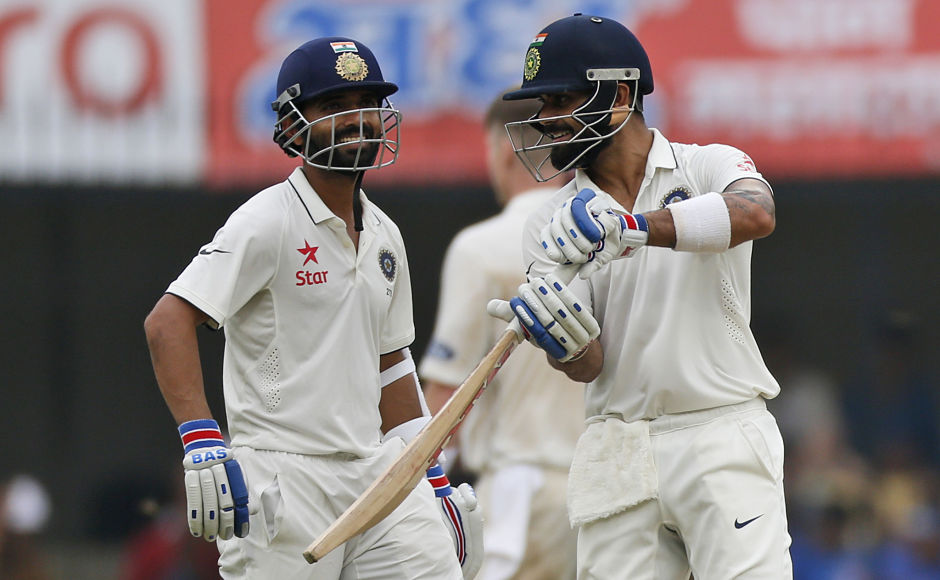 Indian cricket captain Virat Kohli, right, speaks with teammate Ajinkya Rahane on the first day of their third cricket test match against New Zealand in Indore, India, Saturday, Oct. 8, 2016. (AP Photo/Rafiq Maqbool)